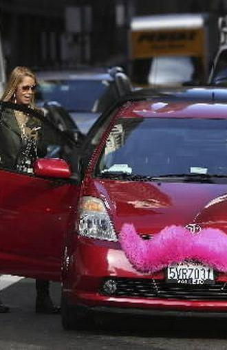 Lyft driver picks up passenger in San Francisco...and will soon also do the same in Windermere/Orlando area (Lyft handout photo/July 31, 2014)
