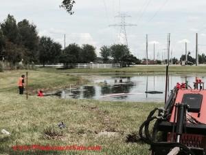 Lakes of Windermre Fountain Repair2-repair guys (credit: Windermere Sun-Susan Sun Nunamaker)