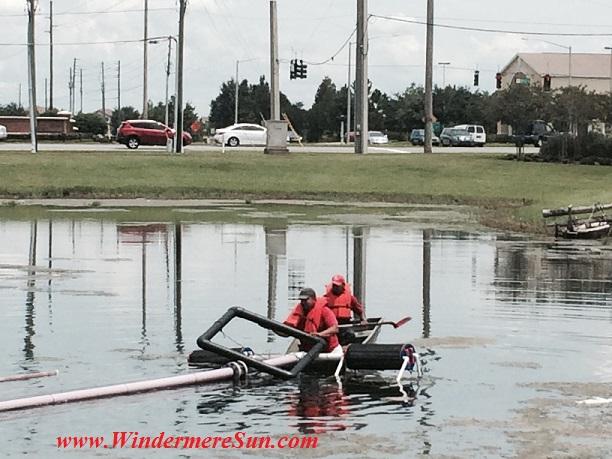 Lakes of Windermre Fountain Repair4-repair guys (credit: Windermere Sun-Susan Sun Nunamaker)