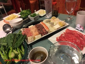 Hotto Potto (3090 Aloma Ave., #150, Winter Park, FL 32792, 407-951-8028 soon to be moved to 1700 Semoran Ave., Orlando, FL in February) sampling plate w vegetables, dumplings, and meats (credit: Windermere Sun-Susan Sun Nunamaker)
