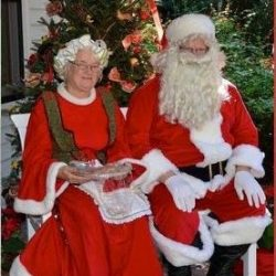 Santa & Mrs. Claus at Holiday Amaryllis Festival of Nehrling Gardens (credit: Nehrling Gardens)