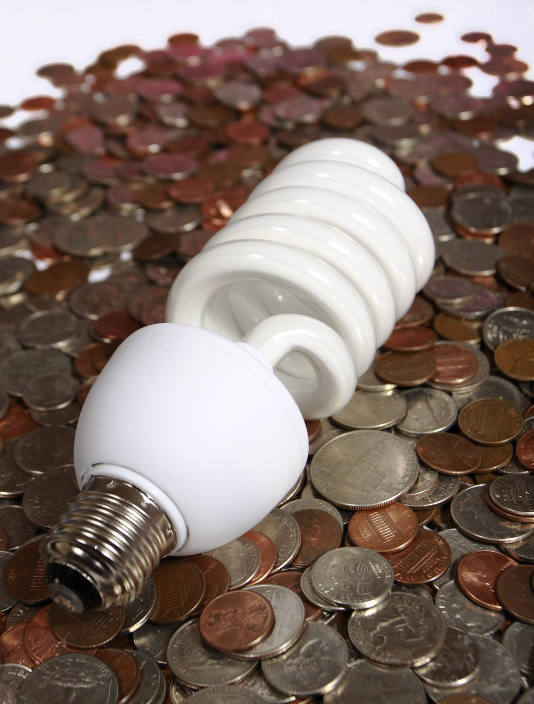saving money cfl-and-coins-1155203 by Claudio Jule