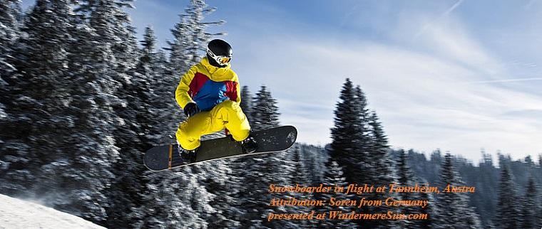 Snowboarder_in_flight_(Tannheim,_Austria), attribution-Sören from Germany final