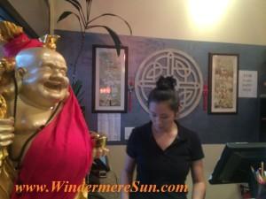Beautiful Tao Asian Owner Victoria next to Buddha (credit: Windermere Sun-Susan Sun Nunamaker)
