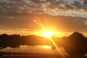 Sunset-sun rays by lake in Central Florida (credit: Windermere Sun-Susan Sun Nunamaker)