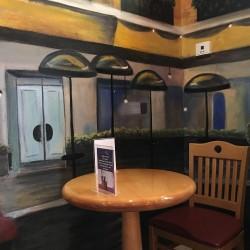Le Cafe de Paris, 5170 Dr. Phillips Blvd., Orlando, FL , 407-293-2326 -shining table (credit: Windermere Sun-Susan Sun Nunamaker)
