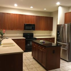 Huge kitchen with tile floor and lots of cabinets, recessed lighting in ceiling, butler pantry, kitchen pantry, and reverse osmosis system below sink to insure high quality drinking water (photo credit: Windermere Sun-Susan Sun Nunamaker)