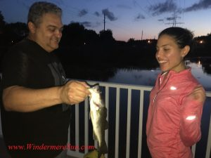 Windermere fishing Family Father Pedro & Daughter Michelle make good use of the community dock (credit: Windermere Sun-Susan Sun Nunamaker)