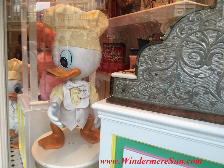 Louie the Duck on display inside Magic Kingdom on Main Street. Many people got the same idea: Beautiful sunny day to visit Magic Kingdom (credit: Windermere Sun-Susan Sun Nunamaker)