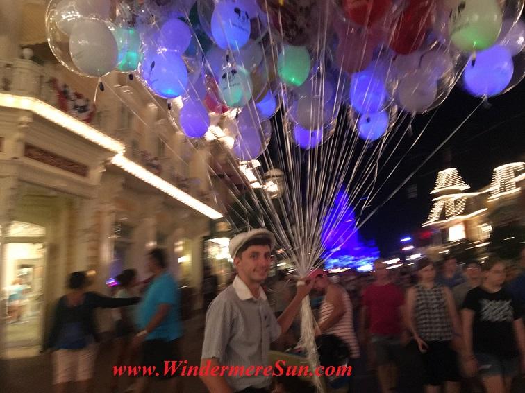 Balloons vendors at Magic Kingdom. Many people got the same idea: Beautiful sunny day to visit Magic Kingdom (credit: Windermere Sun-Susan Sun Nunamaker)
