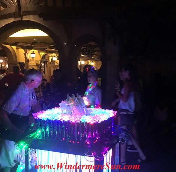 Vendor for Disney light toys inside Magic Kingdom. Many people got the same idea: Beautiful sunny day to visit Magic Kingdom (credit: Windermere Sun-Susan Sun Nunamaker)